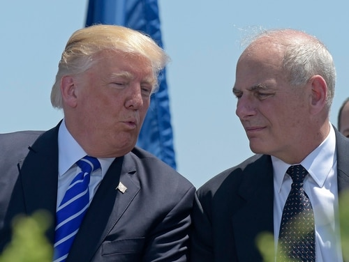 President Donald Trump, left, talks with Chief of Staff John Kelly, who at the time was the Homeland Security secretary, during commencement exercises at the U.S. Coast Guard Academy May 17, 2017. (Susan Walsh/AP)