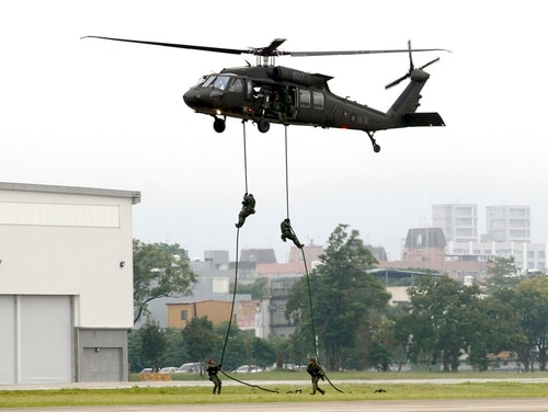 Members of Taiwan's special forces rappel from a UH-60M Black Hawk helicopter during a military drill in Taoyuan city, Nothern Taiwan. (Chiang Ying-ying/AP)