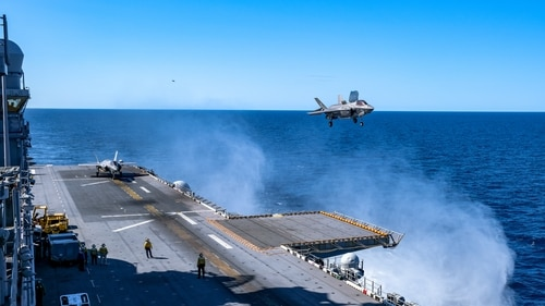 A U.S. Marine Corps F-35B jet prepares to land on the flight deck aboard the amphibious assault ship America during Talisman Sabre on July 17, 2021. (Staff Sgt. John Tetrault/U.S. Marine Corps)
