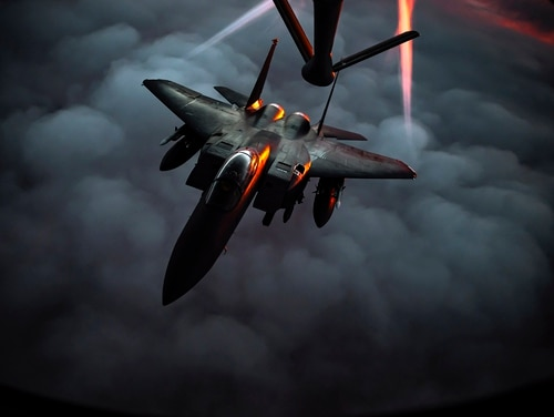 A U.S. Air Force F-15E Strike Eagle departs after receiving fuel from a U.S. Air Force KC-135 Stratotanker during an air refueling mission over Southwest Asia, Dec. 22, 2020. (Staff Sgt. Trevor T. McBride/Air Force)