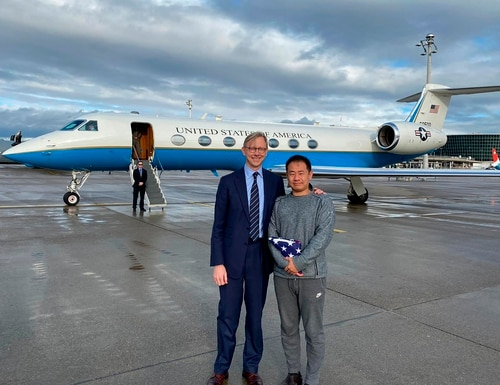 U.S. special representative for Iran, Brian Hook, stands with Xiyue Wang in Zurich, Switzerland on Saturday. In a trade conducted in Zurich, Iranian officials handed over Chinese-American graduate student Xiyue Wang, detained in Tehran since 2016, for scientist Massoud Soleimani, who had faced a federal trial in Georgia. (U.S. State Department via AP)