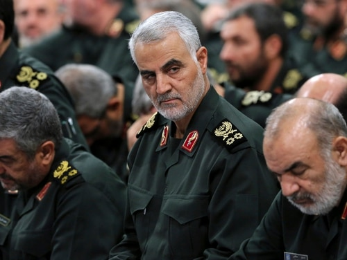 In this Sept. 18, 2016, photo provided by an official website of the office of the Iranian supreme leader, Revolutionary Guard Gen. Qassem Soleimani, center, attends a meeting in Tehran, Iran. (Office of the Iranian Supreme Leader via AP)