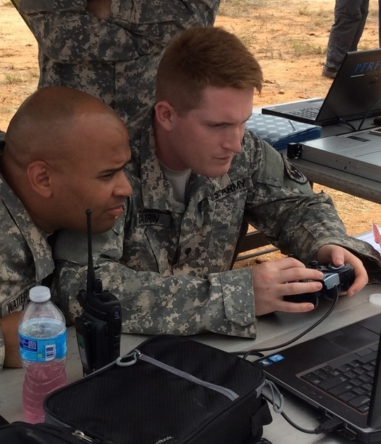 Sgt. 1st Class Ian Watterson and Spc. Tyler Carrin, both with the 111th Military Intelligence Brigade, operate WASP and FMV from the Enterprise Challenge's Forward Operating Base during exercise at Fort Huachuca, Ariz., (Kristen Kushiyama/U.S. Army)