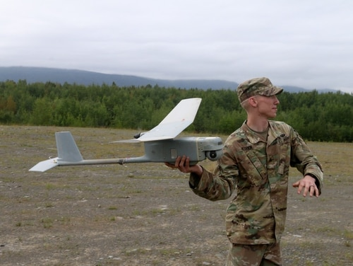 A paratrooper with Headquarters, Headquarters Company, 725th Brigade Support Battalion, demonstrates the launch of the Raven Unmanned Aerial Surveillance. (Sgt. Alex Skripnichuk/Army)