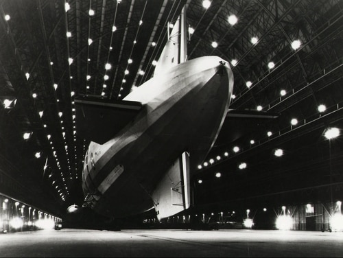 The airship USS Macon is moored at Hangar One at Moffett Federal Airfield near Mountain View, Calif. The airship crashed off the coast of California in 1935, and decades later still haunted the public. As a result, one proposal never got past the discussion stage despite the considerable media attention it received. (U.S. Navy)