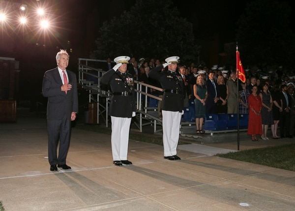 From left, Secretary of the Navy Richard V. Spencer, Commandant of the Marine Corps Gen. David H. Berger, and Col. Donald J. Tomich, the commanding officer of Marine Barracks Washington, D.C., render honors during an Aug. 2 parade. (Cpl. James Bourgeois/Navy)
