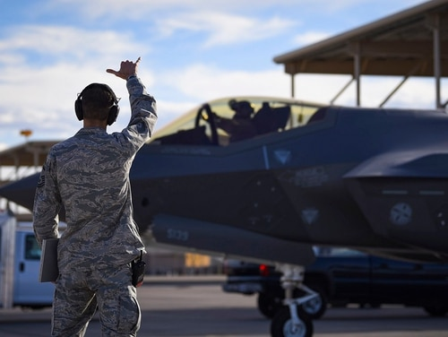 Master Sgt. Thomas Puckett, 57th Aircraft Maintenance Squadron Lightning Aircraft Maintenance Unit aircraft section chief, sends off an F-35 fighter jet assigned to the 6th Weapons Squadron at Nellis Air Force Base, Nevada, May 29, 2018. (Airman 1st Class Andrew D. Sarver/U.S. Air Force)