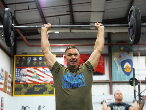 Master Sgt. Charles Johnson lifts weights during a CrossFit competition at Camp Arifjan, Kuwait. Army Recruiting Command is standing up a functional fitness team where soldiers will work out and travel full-time. (Sgt. Dylan Grace/Army)