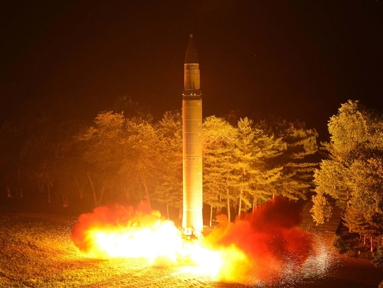 This July 28, 2017, photo distributed by the North Korean government shows what was said to be the launch of a Hwasong-14 intercontinental ballistic missile at an undisclosed location in North Korea. North Korea was the main concern cited in a white paper approved by Japan's Cabinet on Aug. 8, 2017, less than two weeks after the North test-fired its second ICBM. (Korean Central News Agency/Korea News Service via AP)