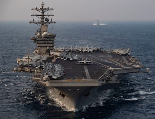 The aircraft carrier USS Nimitz (CVN 68) steams ahead of the guided-missile cruiser USS Princeton (CG 59) while participating in Malabar 2020 in the north Arabian Sea on Nov. 17, 2020. (MC3 Elliot Schaudt/Navy)