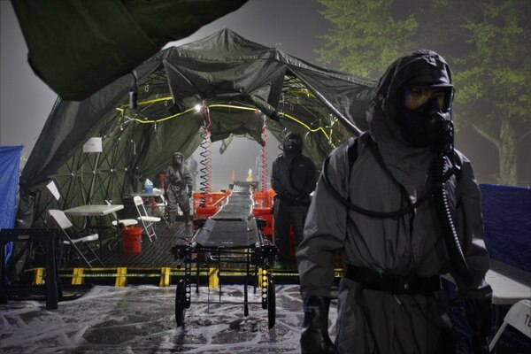 Soldiers from 181st Chemical Company (Hazard Response), Task Force Ops, Joint Task Force Civil Support are prepared for role players to come through their mass casualty decontamination line at Exercise Guardian Response at Muscatatuck Urban Training Center on May 4. (2nd Lt. Corey Maisch/Army)