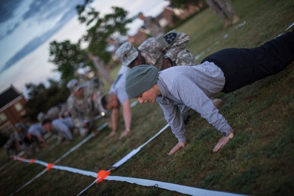 Spc. Mekel Bergschneider, a Cannon, Ga., native with 702nd Brigade Support Battlion, 4th Stryker Brigade Combat Team, 2nd Infantry Division, is graded on her pushups during the Army Physical Fitness Test, May 15. The APFT was the first event for Bergschneider, and 12 other soldiers and noncommissed officers, during the 2013 Bayonet Soldier and NCO of the Year competition.