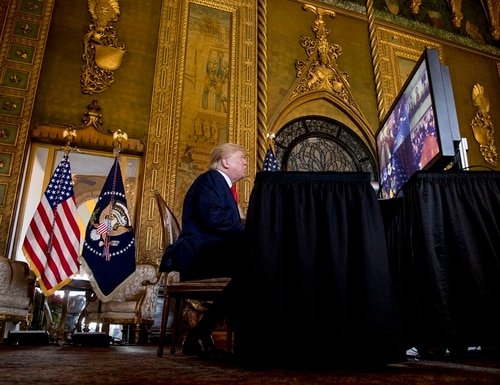 President Donald Trump speaks during a Christmas Eve video teleconference with members of the military at his Mar-a-Lago estate in Palm Beach, Fla., Tuesday, Dec. 24, 2019. (Andrew Harnik/AP)