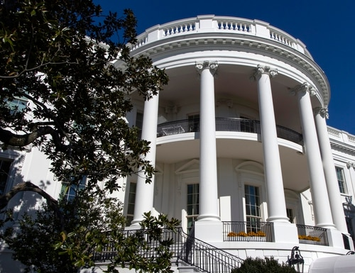 """In this Nov. 3, 2019, photo, the south side of the White House is pictured before President Donald Trump arrives. Victoria Coates, a top official on the National Security Council, is being reassigned amid fallout over the identity of the author of the inside-the-White House tell-all book by """"Anonymous."""" (Jon Elswick/AP)"""