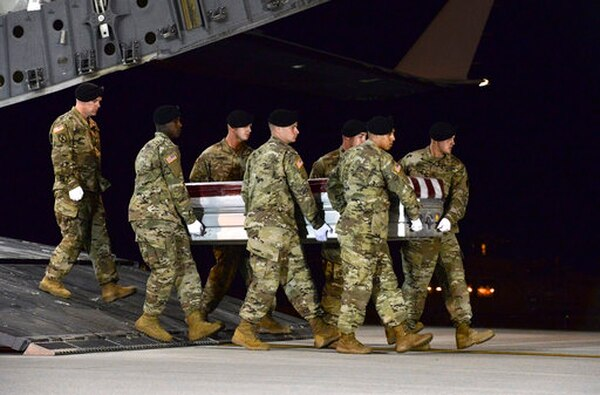 A U.S. Army carry team transfers the remains of Army Staff Sgt. Dustin Wright of Lyons, Ga., late Thursday, Oct. 5, 2017, upon arrival at Dover Air Force Base, Del. Wright was one of four U.S. troops and four Niger forces killed in an ambush in Niger earlier this month. (Staff Sgt. Aaron J. Jenne/Air Force)