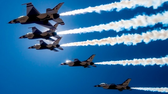 "The U.S Air Force Air Demonstration Squadron ""Thunderbirds"" fly over Las Vegas on April 11, 2020, to show appreciation and support for the health-care workers, first responders and other essential personnel working on the front lines to combat COVID-19. (Staff Sgt. Cory W. Bush/Air Force)"