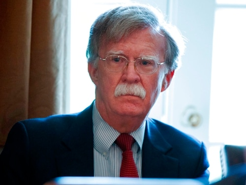 In this April 9, 2018, file photo, National Security Adviser John Bolton listens as President Donald Trump speaks during a Cabinet meeting at the White House in Washington. After announcing early Wednesday that it was pulling out of high-level talks with Seoul because of a new round of U.S.-South Korea military exercises, the North took aim at Bolton and said it might have to reconsider whether to proceed with the summit between Trump and North Korean leader Kim Jong Un because it doubts how seriously Washington actually wants peaceful dialogue. (Evan Vucci/AP)