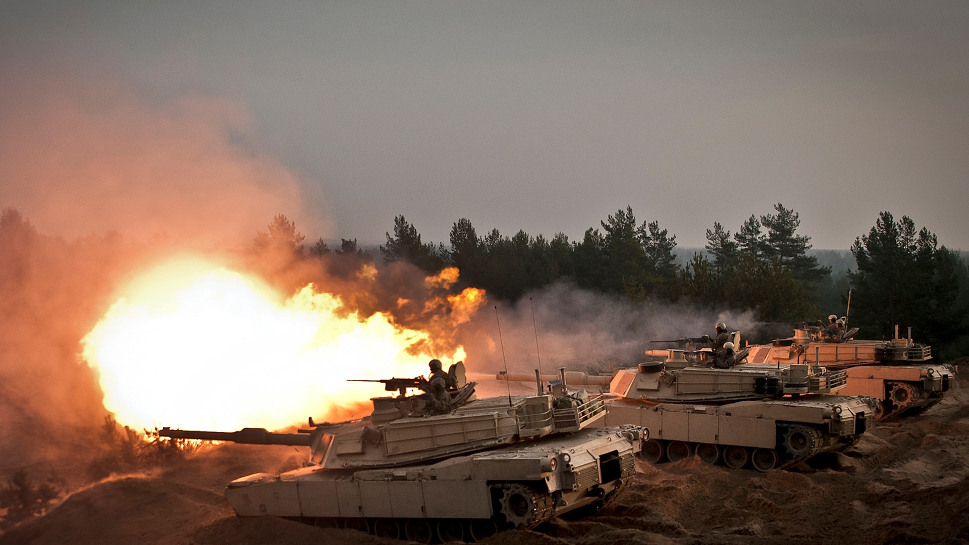 M1A2 Abrams tanks fire at the Adazi Training Area in Latvia. (Sgt. 1st Class Jeremy J. Fowler/Army)