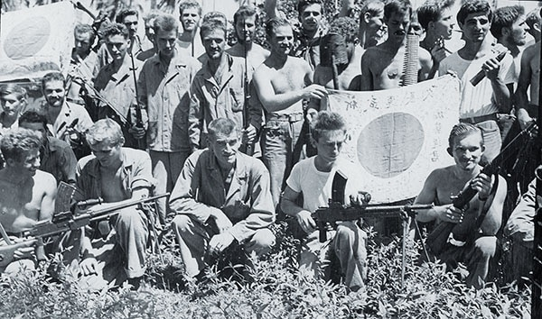 Two companies helped defend Midway Island from Japanese aerial attack in June, before Carlson (left, with Major Ralph Coyte) led the battalion on Makin and Guadalcanal. After their month-long patrol, the Raiders (above) were mentally and physically exhausted, but satisfied with their success in decimating Japanese forces across Guadalcanal.