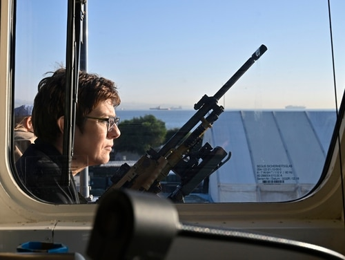 German Defence Minister Annegret Kramp-Karrenbauer stands next to a machine gun aboard a military corvette during her two-day visit to the German contingent of the United Nations Interim Force in Lebanon mission in December 2019 in Limassol, Cyprus. (Tobias Schwarz/AFP via Getty Images)