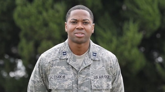 Then-Capt. Stephen Osakue sends a holiday greeting to Alexandria, Virginia, from Kunsan Air Base, South Korea, in October 2013.