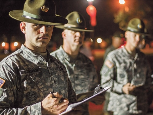 Drill Sergeant Sgt. Dan Kernan keeps track of Best Warrior competitors during the 2015 U.S. Army Reserve Best Warrior Competition at Fort Bragg, N.C. (Sgt. Felix R. Fimbres/Army)