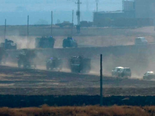 Military vehicles move in convoy along a road in Sevimli, Mardin Province, Turkey, Friday Nov. 1, 2019. Turkey and Russia launched joint patrols Friday in northeastern Syria, under a deal that halted a Turkish offensive against Syrian Kurdish fighters who were forced to withdraw from the border area following Ankara's incursion. (AP Photo)