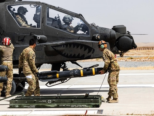 U.S. Army soldiers load an AGM-114 Hellfire missile on an AH-64E Apache helicopter in Kunduz, Afghanistan. The Joint Air-to-Ground Missile will replace Hellfire. (Capt. Brian Harris/U.S. Army)