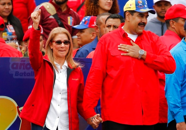 Venezuela's President Nicolas Maduro and first lady Cilia Flores acknowledge supporters at the end of a rally in Caracas, Venezuela, on Saturday. Maduro called the rally to celebrate the 20th anniversary of the late President Hugo Chavez's rise to power. (Ariana Cubillos/AP)