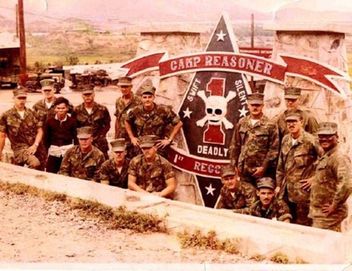 Marines with 1st Reconnaissance Battalion stand by the sign marking the entrance of their Vietnam headquarters. (Courtesy of Rep. Mike Gallagher, R-Wis.)
