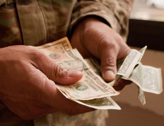 A provision in the upcoming spending bill would ease troops' pain in repaying the deferred payroll taxes. (Kristen Wong/DoD)