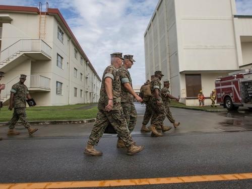 Commandant of the Marine Corps Gen. Robert B. Neller walks with Maj. Gen. Richard L. Simcock II, commanding general, 3d Marine Division, before a town hall at Camp Hansen, Okinawa, Japan, Oct. 13, 2016. (Cpl. Samantha K. Braun)
