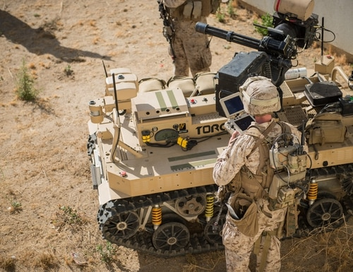 Marines with 3rd Battalion, 5th Marine Regiment prepare a Weaponized Multi-Utility Tactical Transport vehicle for a patrol at Marine Corps Base Camp Pendleton, Calif., July 13, 2016. The system is a multifunction force multiplier configured to persist, protect and project the small unit built by the Marine Corps Warfighting Laboratory. The lab is conducting a Marine Air-Ground Task Force Integrated Experiment in conjunction with Rim of the Pacific exercise to explore new gear and assess its capabilities for potential future use. The Warfighting Lab identifies possible challenges of the future, develops new warfighting concepts, and tests new ideas to help develop equipment that meets the challenges of the future operating environment.