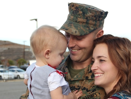 After a six-month deployment to Okinawa, Sgt. Christopher Lafriniere, a communications specialist with 3rd Battalion, 5th Marine Regiment, I Marine Expeditionary Force, greets his family at Marine Corps Base Camp Pendleton, Calif., Nov. 18, 2014. (Lance Cpl. Caitlin Bevel/Marine Corps)