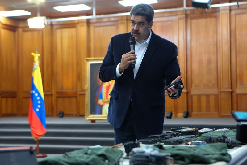 This photo released by the Venezuelan Miraflores presidential press office shows President Nicolas Maduro speaking over military equipment that he says was seized during an incursion into Venezuela, during his televised address from Miraflores in Caracas, Venezuela, Monday, May 4, 2020. (Miraflores press office via AP)
