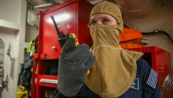 Yeoman 1st Class Kelly Pyron from U.S. Fleet Forces Command, wears the flame-resistant, two-piece organizational clothing prototype on board the aircraft carrier Harry S. Truman. (Mass Communication Specialist 2nd Class Stacy M. Atkins Ricks/Navy)