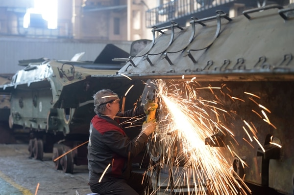 Employees of a military vehicles repair factory renovate and repair T-34 tanks handed over by Laos to Russia, in Strelna, Russia, on Feb. 25, 2020. (Olga Maltseva/AFP via Getty Images)