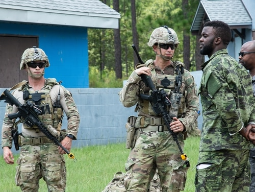 Advisors with 1st Security Force Assistant Brigade meet simulated international forces during the Advisor Forge training exercise Fort Benning on Aug. 14, 2019. (Pfc. Daniel J. Alkana/Army)