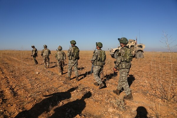 U.S. and Turkish soldiers conduct the first-ever combined joint patrol on Nov. 1, 2018, outside Manbij, Syria. (Spc. Arnada Jones/Army)