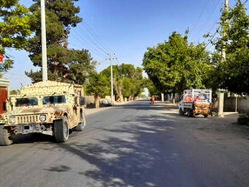 An Afghan army Humvee patrols June 21 in Kunduz city, north of Kabul, Afghanistan, just before the Taliban took over the provincial capital. Thousands of U.S. troops are deploying to Kabul in anticipation of a Taliban siege. (Abdullah Sahil/AP)