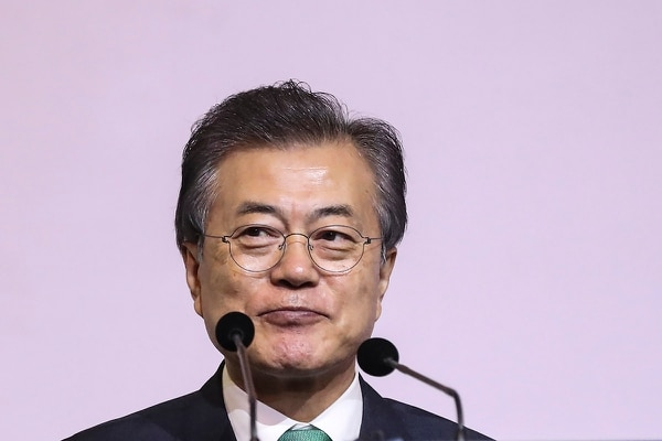 South Korea's President Moon Jae-in greets the audience prior to delivering the 42nd Singapore Lecture organized by the Institute of South East Asian Studies (ISEAS) in Singapore, Friday, July 13, 2018. (Yong Teck Lim/AP)