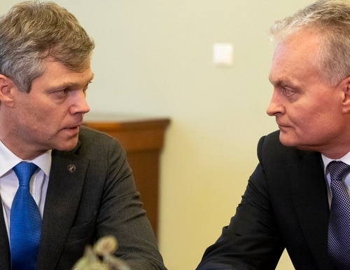 Lithuania's President Gitanas Nauseda, right, speaks to the Director of the State Security Department Darius Jauniskis prior to their meeting at the Presidential palace in Vilnius, Lithuania, on Friday. Lithuania's president pardoned two Russians convicted of spying, his office said Friday, a move seen as a step toward a spy swap with neighboring Russia that could include a Norwegian citizen serving a 14-year sentence for espionage. (Mindaugas Kulbis/AP)