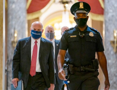 Postmaster General Louis DeJoy, left, is escorted to House Speaker Nancy Pelosi's office on Capitol Hill in Washington, Wednesday, Aug. 5, 2020. (Carolyn Kaster/AP)