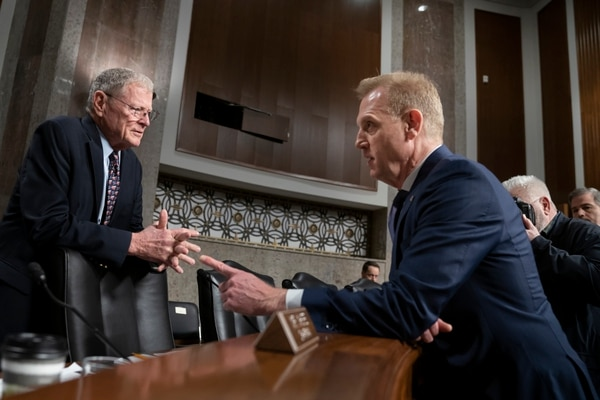 Senate Armed Services Committee Chairman Jim Inhofe, R-Okla., left, welcomes acting Defense Secretary Patrick Shanahan to testify on the Pentagon's budget on March 14, 2019. (/J. Scott Applewhite/AP)