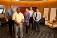 Verizon employees pose for photos at Verizon Headquarters in Basking Ridge, N.J. , on Monday, April 6, 2015. From left: Lloyd Cook, Army; Robert Forrest, Army; Monica Orecchio, Army spouse; Daniel Falkner, Navy and Thomas Jones, Army. (Mike Morones/Staff)