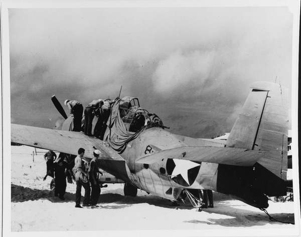 A Grumman TBF-1 Avenger of Torpedo Squadron 8, photographed at Midway, 25 June 1942, prior to shipment back to the United States for post-battle evaluation. Badly shot-up, this plane was the only survivor of six Midway-based VT-8 TBFs that had attacked the Japanese carrier force in the morning of 4 June. The plane's pilot was Ensign Albert K. Earnest. Crew were ARM3c Harrier H. Ferrier and S1c Jay D. Manning. Manning, who was operating the .50-caliber machine-gun turret, was killed in action with Japanese fighters during the attack (National Archives)