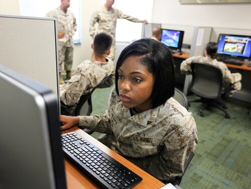 Lance Cpl. Malishya Lott, a supply warehouse clerk with I Marine Expeditionary Force Headquarters Group, tests a new computer at Camp Pendleton, California, in 2012. (Cpl. Joshua Young/Marine Corps)