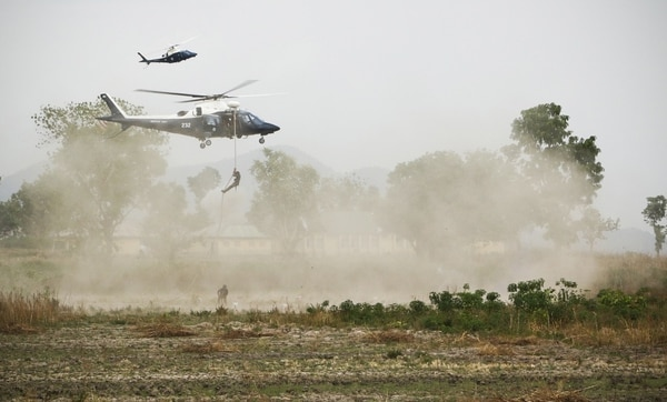 "Nigerian Special Force soldiers repel from a helicopter during operation ""Silent Kill"" in Abuja, Nigeria, April 17, 2018. U.S. special operations forces often train and advise local units to help build strategic alliances and strengthen internal security of other countries. (Spc. Angelica Gardner/Army)"