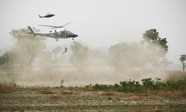 """Nigerian Special Force soldiers repel from a helicopter during operation """"Silent Kill"""" in Abuja, Nigeria, April 17, 2018. U.S. special operations forces often train and advise local units to help build strategic alliances and strengthen internal security of other countries. (Spc. Angelica Gardner/Army)"""