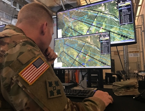 A soldier in Tampa, Florida, assesses the Army's One World Terrain software, which will be used to create real-time, realistic simulated terrain for soldiers to fight on. (Army)